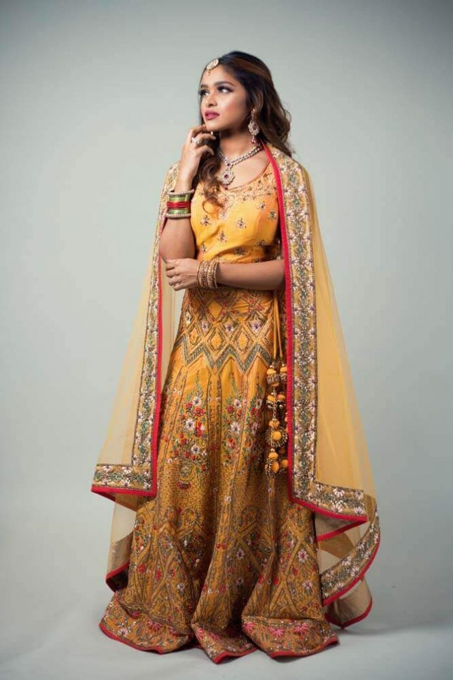 yellow, pink, and gold bridal lengha