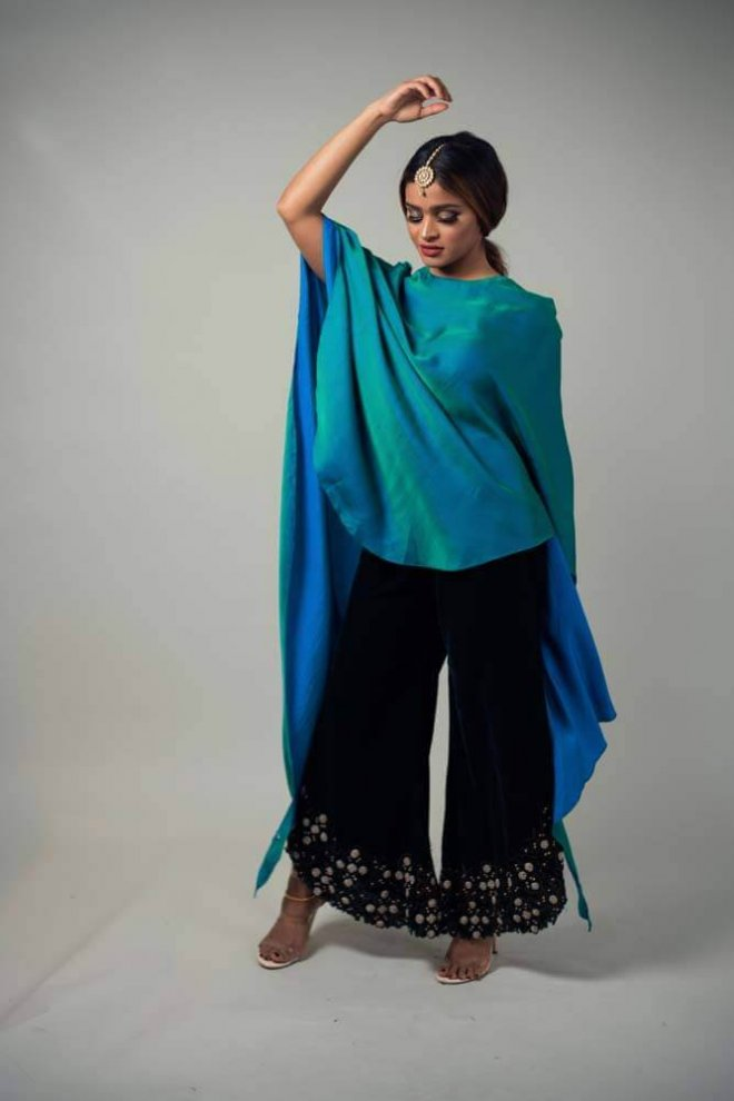 teal silk blouse and green velvet pants