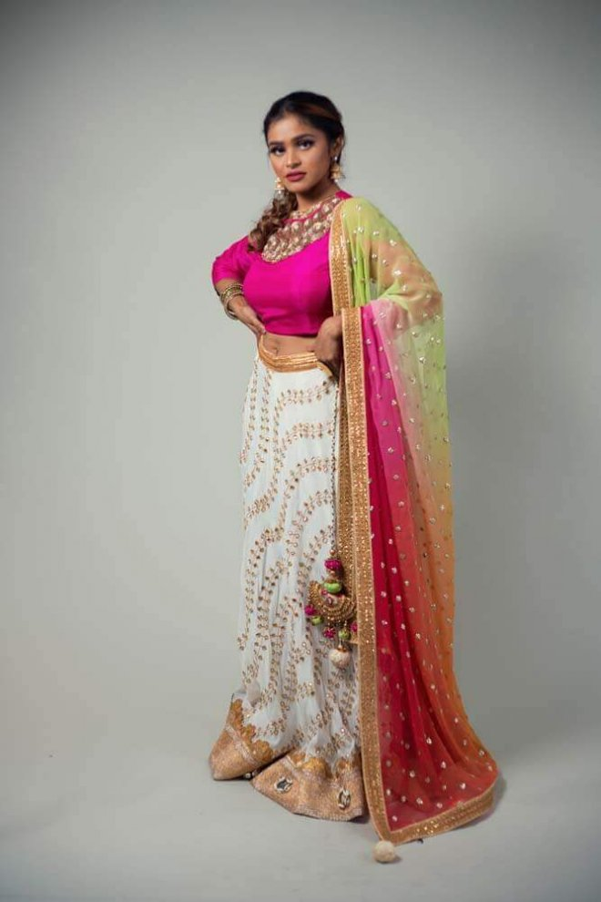 pink, gold, and white lengha