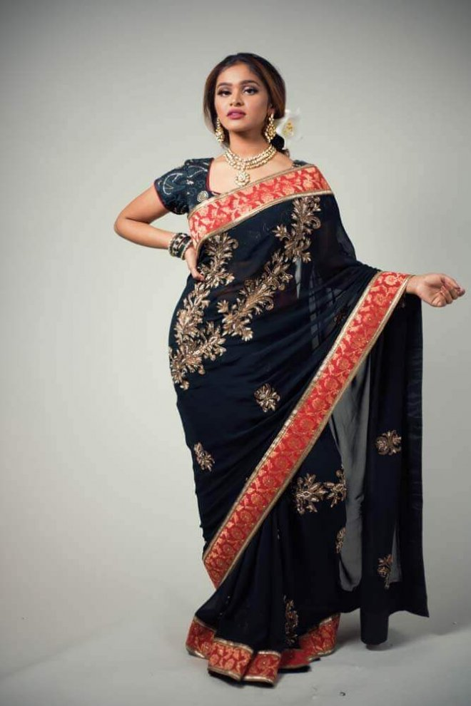 black, gold, and red sari